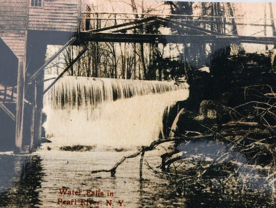 Vintage photo of waterfall and grist mill at the Haring