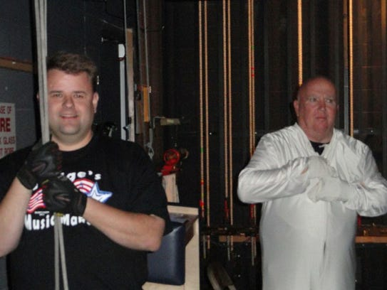 Jason Dart (left) lifting the curtain during a community