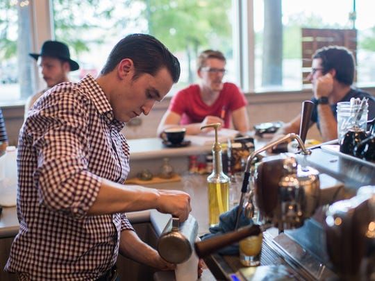 Co-owner Nathanael Johnson pours a coffee drink at Reve Coffee Roasters in downtown Lafayette, La., Tuesday, Sept. 15, 2015. The business recently relocated to 200A Jefferson Street in downtown Lafayette