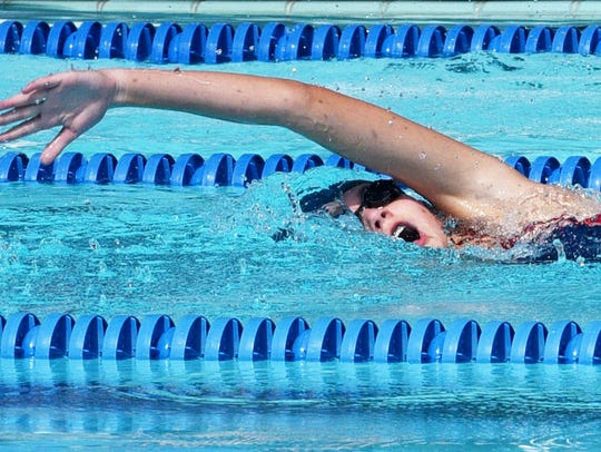 Riley Quinlan competes in the 100 freestyle race during
