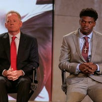 Louisville head coach Bobby Petrino, left, Lamar Jackson, right, listen during a news conference at the Atlantic Coast Conference Football Kickoff in Charlotte, N.C., Friday, July 22, 2016. (AP Photo/Chuck Burton)