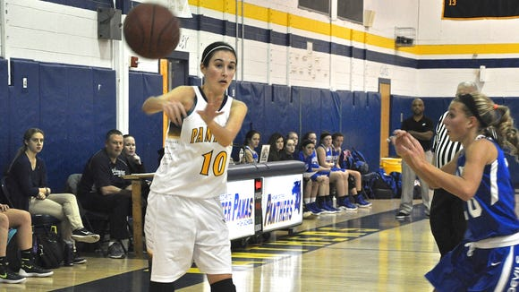 Panas guard Kellie Brown, who drained two 3-pointers, passes during Panas' win over Haldane.