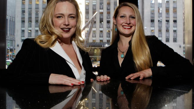 Kristin Beckler, left, and Crystl Faye Horton-Friedman pose for a photo at Del Frisco's in New York. Both women are mothers and work as sommeliers at the restaurant. More women are moving up the wine ranks, said Dorothy Cann Hamilton, founder and CEO of the International Culinary Center.