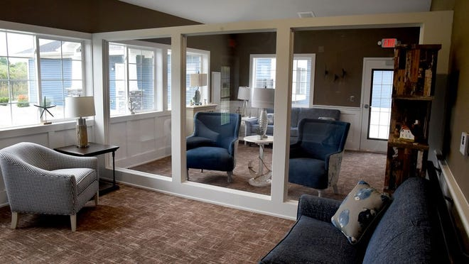 Hampton Manor in Dundee features a new lounge that allows family members to comfortably visit with their loved ones and be separated only by a floor-to-ceiling Plexiglas divider.