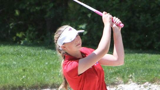 Carmel's Lauren Peter hits out of a bunker on the ninth