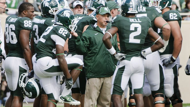 Don Treadwell speaks to the MSU offense while serving as interim coach against Northern Colorado on Sept. 25, 2010 in East Lansing.