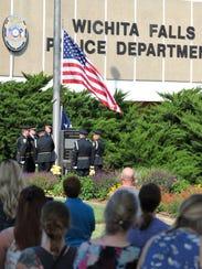 The Wichita Falls police honor guard raised the American