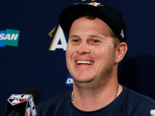Houston Astros starting pitcher Brad Peacock speaks during a news conference, Saturday, Oct. 7, 2017, before his team's workout as they prepare for Sunday's Game 3 of baseball's American League Division Series against the Boston Red Sox in Boston. (AP Photo/Bill Sikes)