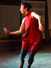 """Mauriah Kraker performs in Wild Space Dance Company's """"Carried Away."""""""