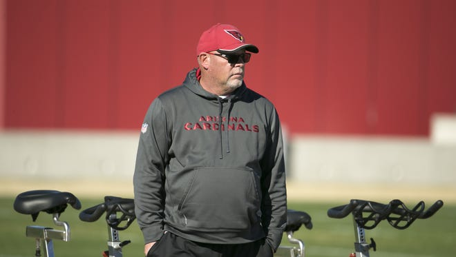 Cardinals head coach Bruce Arians looks on at the start of practice at the Cardinals' practice facility in Tempe on Wednesday, January 13, 2016.