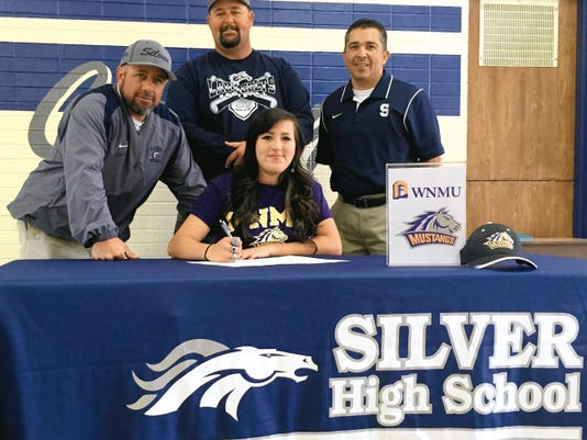 Danny Udero/Sun-News   Silver softball player Carolyn Castillo signs to play for Western New Mexico University with coaches Mike Lopez, left, Duane Trewern, middle and athletic director Victor Oaxaca looking on.