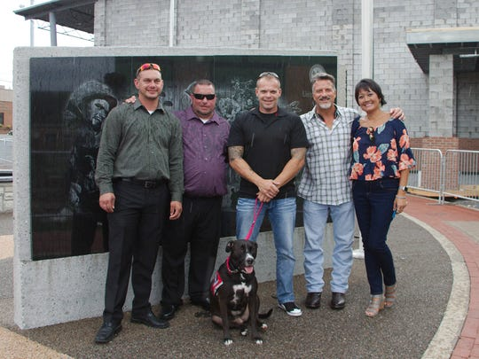 Veteran Staff Sgt. Brian Buckingham, middle, was presented with a service dog named Glory in September from Fallen Soldiers March, which was started by Jim Retzke. Pictured are retired Staff Sgt. Chris Atchley, from left, Shane Connell, Buckingham, Retzke and Gigie Button.