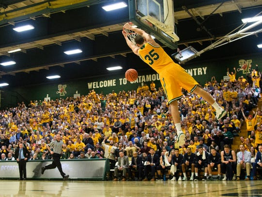 Vermont's Payton Henson dunks the ball during Saturday