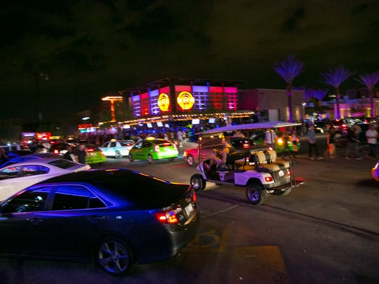 As the clock strikes 2 a.m., people begin leaving the bars and nightclubs in Scottsdale's entertainment district.  Patrick Breen/The Republic