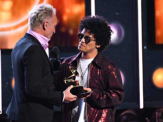 Sting presents  Bruno Mars the song-of-the-year award
