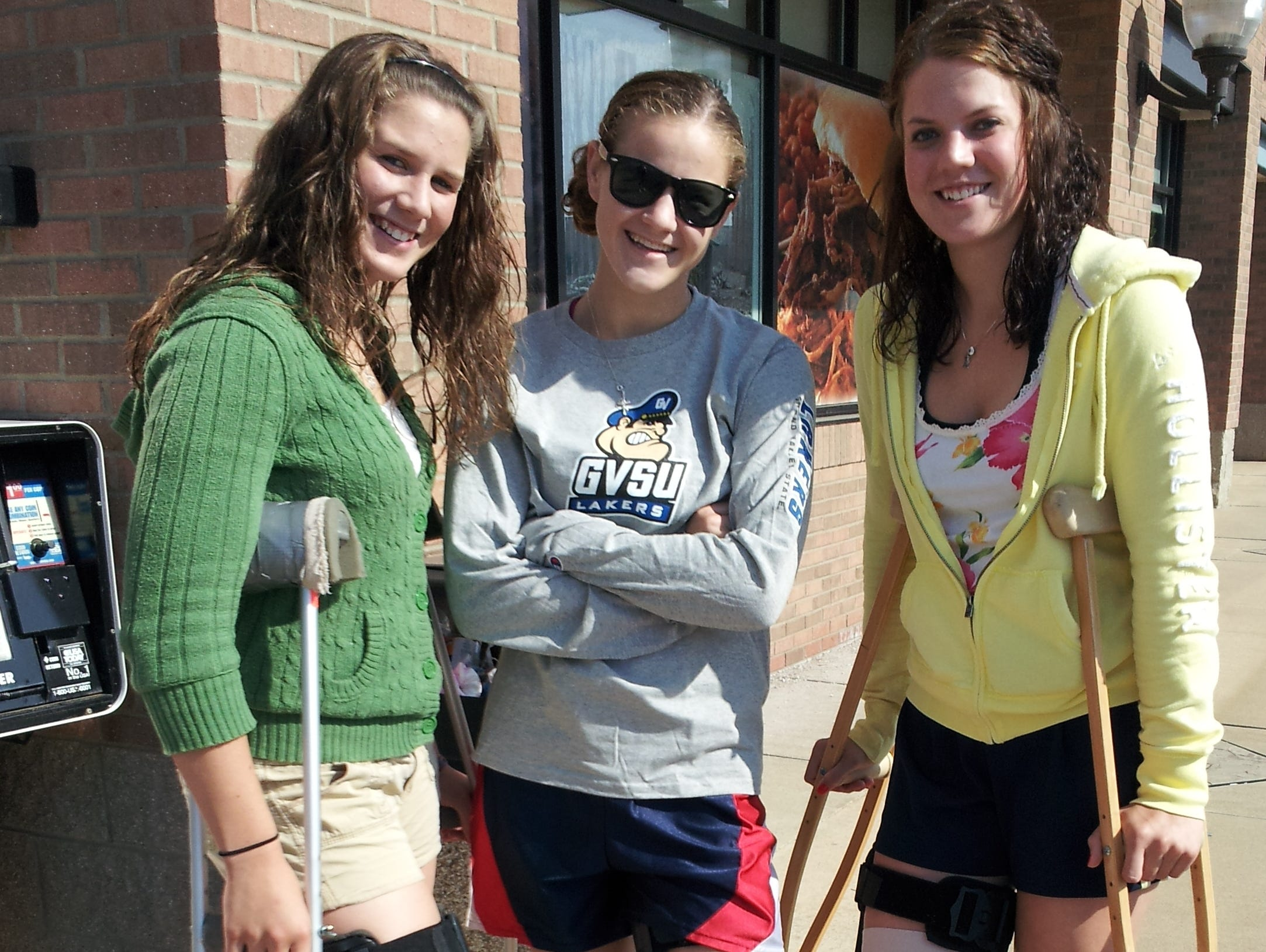 From left Courtney, Rebecca and Addie Ingles pose for a photo on Mothers Day shortly after injuring their knees.