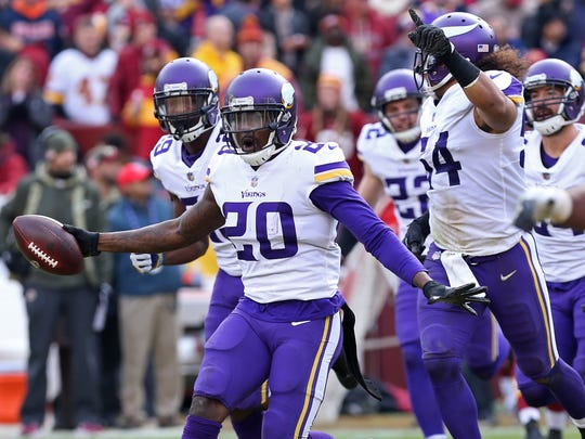 Minnesota Vikings cornerback Mackensie Alexander celebrates with teammates after intercepting a pass against the Washington Redskins in the second quarter at FedEx Field.