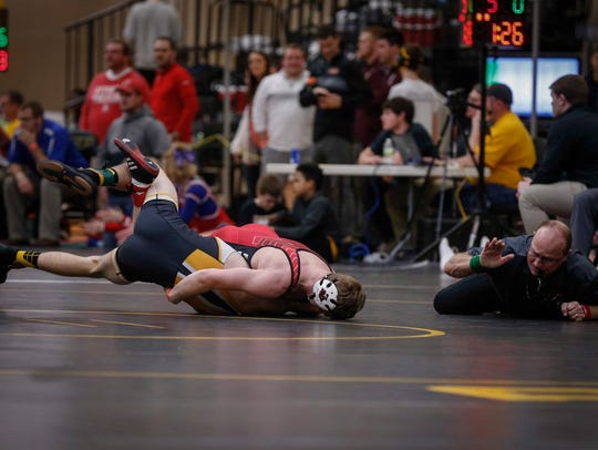 Fort Dodge senior Brody Teske pins Southeast Polk sophomore