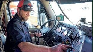 Trevor Hughes Trevor Hughes via Imagn Content Services LLC  Trucker James Rodgers checks a display in his big rig before setting off across Wyoming to deliver a load of cleaning supplies to a warehouse in Salt Lake City.