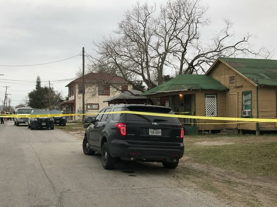 Corpus Christi police officers and detectives investigate the scene of a shooting in the 300 block of Parr Street, near North Port Avenue on Thursday, Jan. 25, 2018.