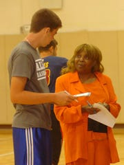 Diane Powell talks with Ardit Dema, 16, at the Costick Center.