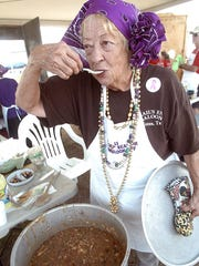 Sandye (CQ, Sandye) Peterson with the team 'Mom's Voodoo Gumbo' prepares her batch of Gumbo for hundreds to taste at the Rockport Seafair.