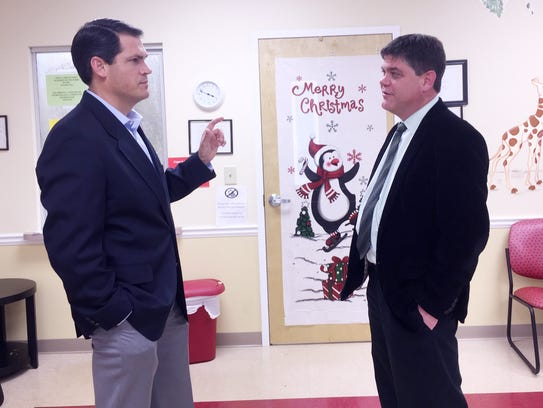 Republican State Rep. Geoff Duncan, left, meets with