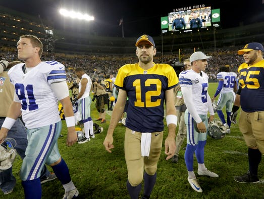 Green Bay Packers quarterback Aaron Rodgers walks off the field after the 30-16 loss against the Dallas Cowboys.   Mike De Sisti, Milwaukee Journal