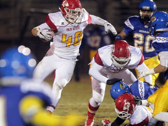 Palm Desert's Tommy Jacobsson carries the ball against Serrano on Friday during the CIF Eastern Division semifinals played in Phelan, CA.