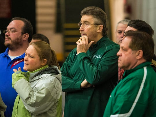 Rice coach Tim Rice watches his team play CVU during the continuation of the D-1 girls semifinal at Patrick Gymnasium in Burlington on Thursday, March 5, 2015.  Rice collapsed, and was revived, during the game on Saturday, which was suspended.