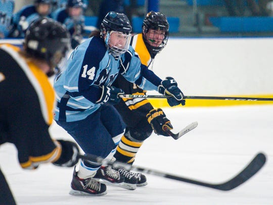 Mt. Mansfield's Patrick Burke, left, chases the down