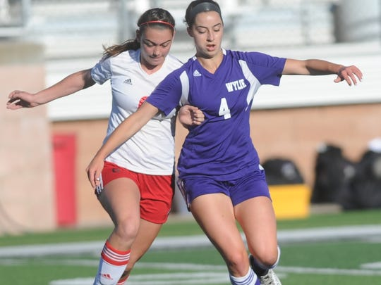 Wylie's Gracie McCaslin (4) tries to fight off a Mineral Wells defender. Mineral Wells won the Region I-4A quarterfinal playoff game 1-0 Monday, April 3, 2017 at Ram Stadium in Mineral Wells.
