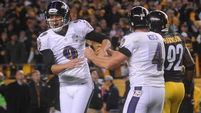 Baltimore Ravens kicker Justin Tucker (9)  is congratulated by holder Sam Koch (4) after kicking the game-winning field goal against the Pittsburgh Steelers during overtime at Heinz Field. The Ravens won the game, 23-20 in overtime.