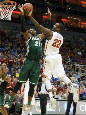 Iowa State forward Dustin Hogue (22) shoots the ball against UAB Blazers forward Tosin Mehinti (21) during the second half of the Round of 64 game Thursday. Hogue failed to score for the first time in his Cyclones career.