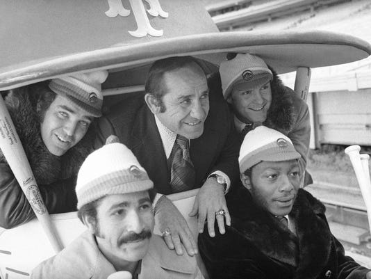 """FILE - In this January 1973 photo, New York Mets manager Yogi Berra, center, poses in the team cart at Shea Stadium in New York with four who signed with the baseball team earlier in the day. They are, back row and from left: Ed Kranepool, Berra, and Tug McGraw. Front row, from left: Felix Millan and John Milner. Cleon Jones also signed, but was not present for the picture session. Bullpen buggies are rolling back, and Cleveland Indians manager Terry Francona is positively bug-eyed about the prospect. """"I love it. I love it. I love it,"""" he said Tuesday, March 6, 2018. Nearly a quarter-century since relievers stopped catching rides to the mound, the bullpen cart will become the latest retro feature to make a return to the big leagues. (AP Photo, File)"""