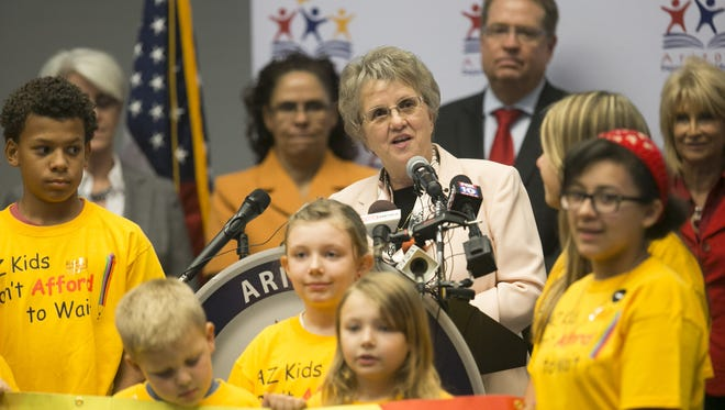 "Flanked by children of Arizona Department of Public Education employees, Arizona Superintendent of Public Instruction Diane Douglas launches her ""We Heard You"" tour during a conference at the Phoenix Art Museum on Thursday, Oct. 1, 2015."