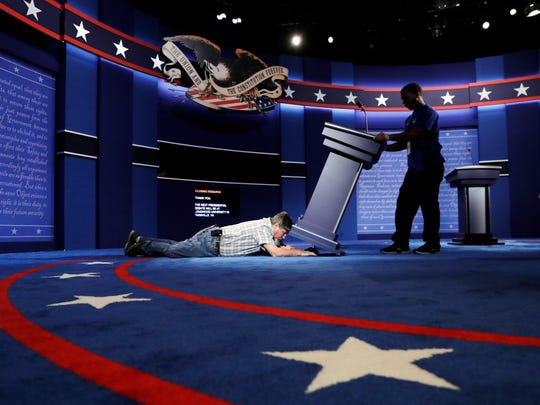 Technicians set up the stage for the presidential debate