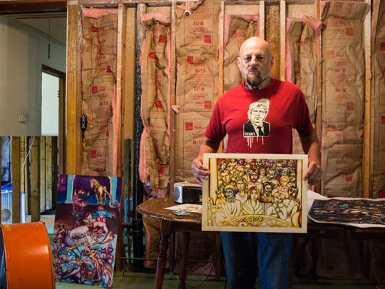 Baker resident and artist Charles Barbier displays his work in his home that he is rebuilding after the flood.