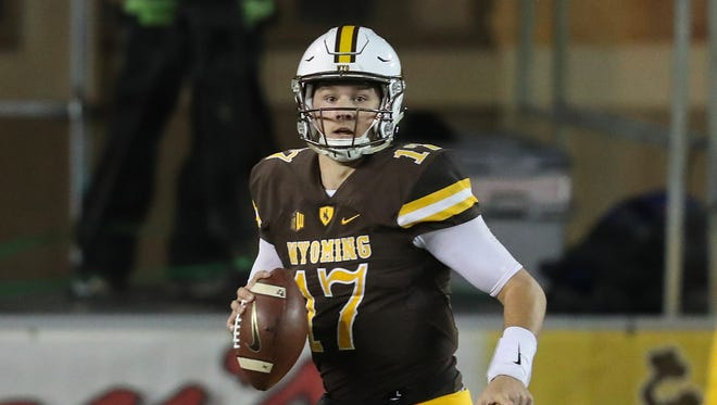 Wyoming Cowboys quarterback Josh Allen (17) looks to throw against the New Mexico Lobos during the second quarter at War Memorial Stadium.