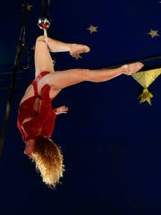 Kimberly Souren performs a one person trapeze act during The Kelly Miller Circus at Kelleys Island on Monday evening.