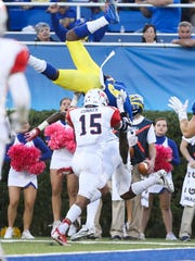 Delaware receiver Jamie Jarmon flips as he is hit and flips into the end zone for a rushing touchdown in the fourth quarter of Delaware's 42-35, double overtime win at Delaware Stadium Saturday.