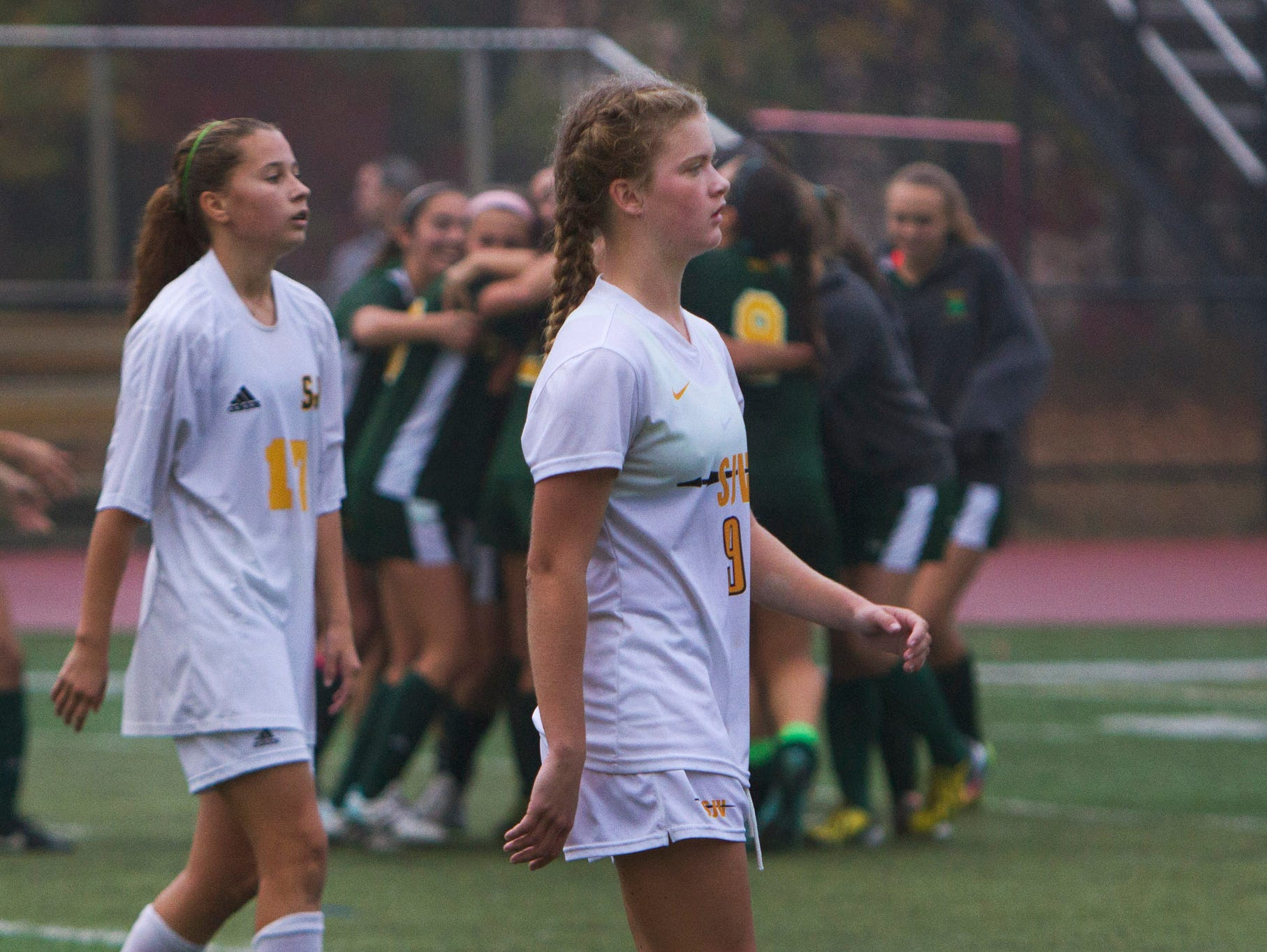 St. John Vianney players try to ignore the RBC celebration going on behind them as they lose 1-0 in state playoff game. Red Bank Catholic vs St. John Vianney in NJSIAA State Soccer tournament