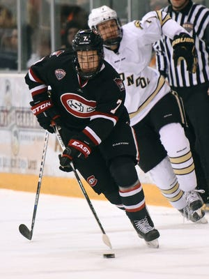 St. Cloud State's Niklas Nevalainen (7) steals the puck from Western Michigan's Matheson Iacopelli last season at the Herb Brooks National Hockey Center. Nevalainen, a senior defenseman from Finland, is likely to see more ice time this weekend for the Huskies when they play in the Desert Hockey Classic in Prescott, Arizona.
