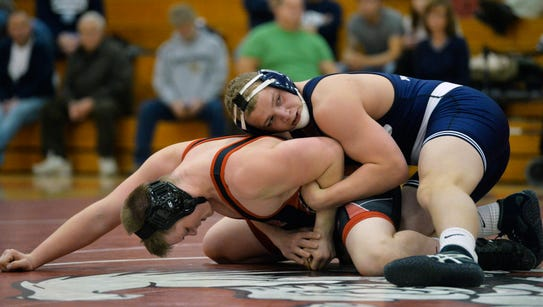 Dover's Ian Flohr, left, and Dallastown's Bryce Shields