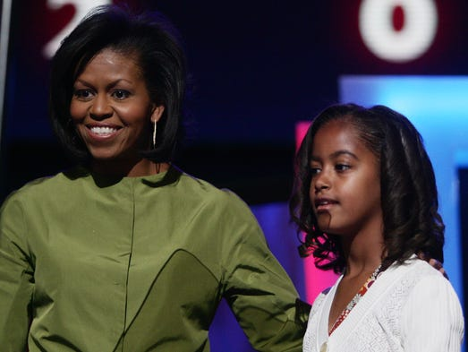 Malia Obama stands with her mother headline speaker