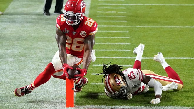 Kansas City Chiefs running back Damien Williams (26) scores around San Francisco 49ers cornerback Richard Sherman (25) during the Super Bowl. Williams is sitting out the NFL season to care for his mother, who has cancer.