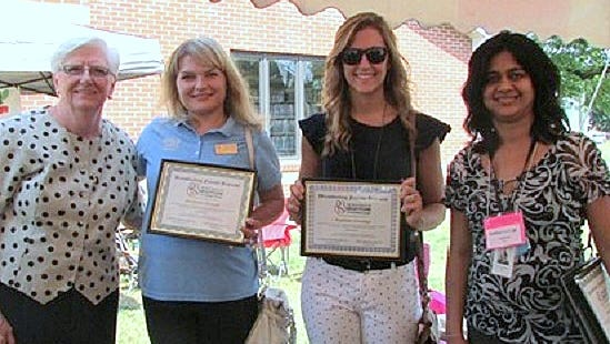Steuben County legislator Carol Ferratella, left, and Ashwini Bakane, right, county WIC breast-feeding coordinator, present certificates to Yuliya Cross, second from left, from Wegmans in Hornell and Diane Macovitch from Wegmans in Corning.