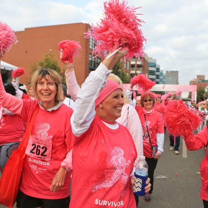 Five-time cancer survivor Sandy Poulter waves to the