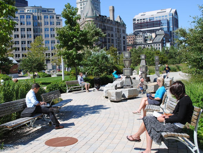 The Greenway is a mile and a half stretch of parks connecting the city. Here, locals sit in a Wharf District park.