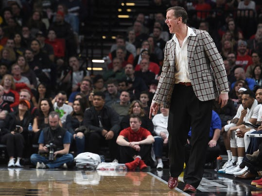 Wearing a plaid blazer in honor of former Portland Trail Blazers coach Jack Ramsay, Blazers coach Terry Stotts yells out to his team during the second half of an NBA basketball game against the Los Angeles Lakers in Portland, Ore., Wednesday, Jan. 25, 2017. The Blazers won 105-98. (AP Photo/Steve Dykes)
